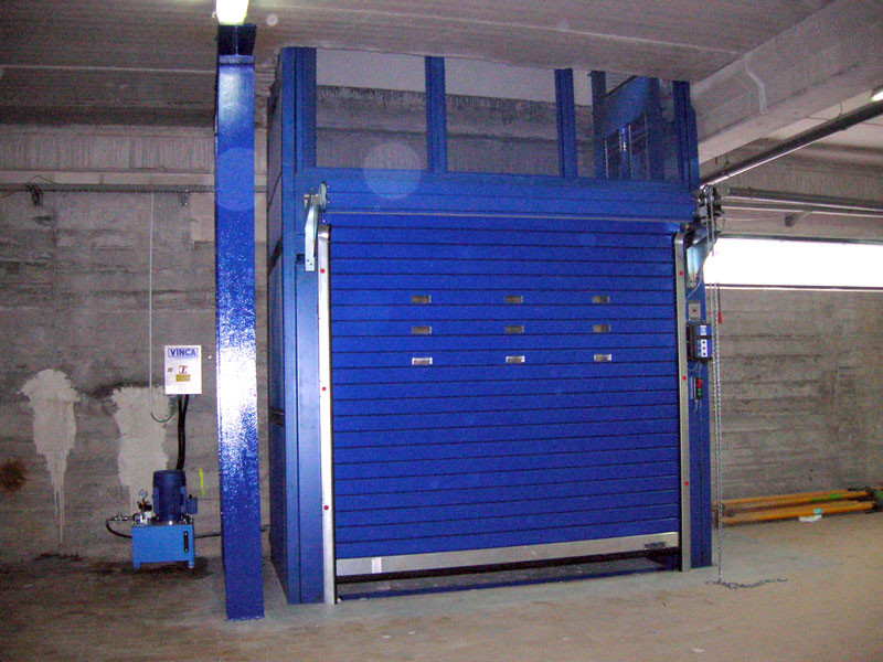 Elevator with roll-up doors and enclosure
