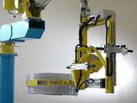 Manipulador de bobinas con pinza exterior