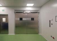 Puertas batientes inoxidables con apertura automática